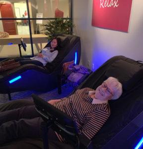 Grandma and granddaughter enjoy a massage