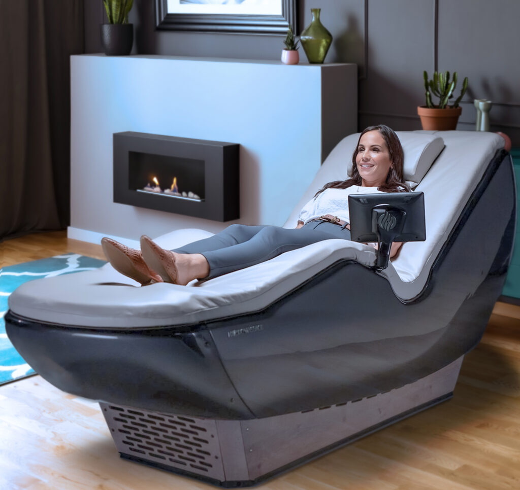 Woman relaxing in a private home massage chair | HydroMassage