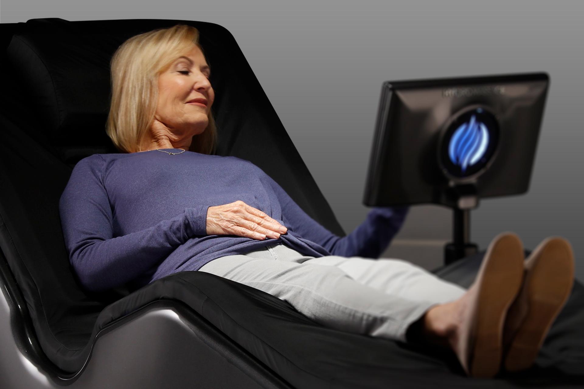 Woman enjoying HydroMassage Lounge