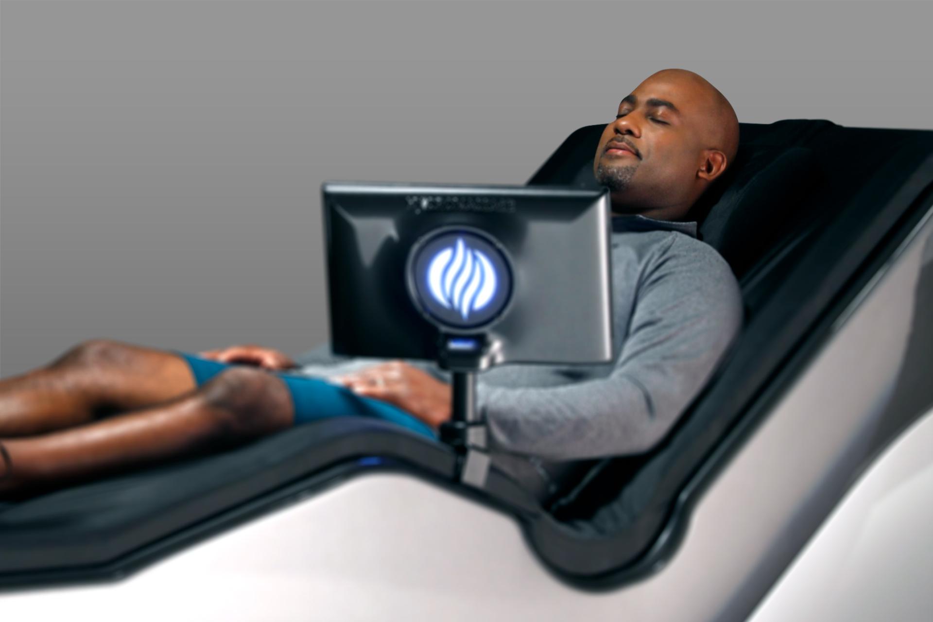Man laying on HydroMassage Lounge