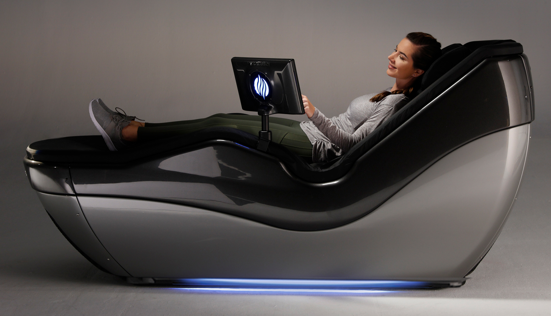 Woman in HydroMassage Lounge pressing button on screen
